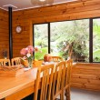 Interior detail of wooden lodge dining room - Stock Photo