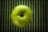 Green apple background — Stock Photo