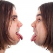 Profile of man face sticking out tongue — Stock Photo