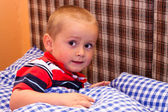 Scared child in bed — Stock Photo