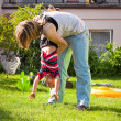 Woman and child boy having fun outdoors — Stock Photo #9235363