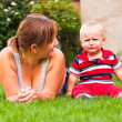 Beautiful young mother and crying toddler boy outdoors — Stock Photo