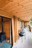 Terrace of mountain wooden lodge — Stock Photo