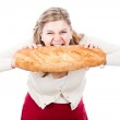 Hungry woman with bread — ストック写真 #9382429