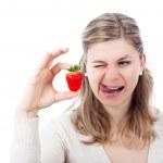 Woman enjoying strawberry — Stockfoto #9484694