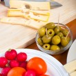Preparing olives and emmenthal cheese — Stock Photo #9658318