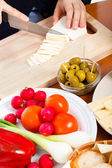 Cutting camembert cheese — Stock Photo