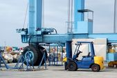 Crane and forklift in port — Stockfoto