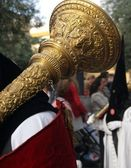 Nazarene carrying a musical instrument in a procession — Stock Photo
