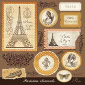 Vector set: symbols of Paris and calligraphic design elements — Stock Vector