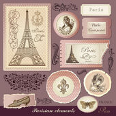 Vector set: symbols of Paris and calligraphic design elements — Stockvector