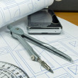 Stock Photo: Architectural concept with blueprint building plans