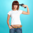 Pretty young woman with gun at head — Stock Photo