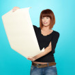 Attractive young woman looking at a drawing — Stock Photo
