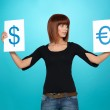 Pretty woman showing dollar and euro signs — Stock Photo
