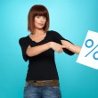 Pretty woman showing percent sign — Stock Photo