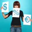 Pretty woman showing dollar, euro, percent signs — Stock Photo