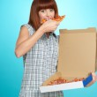 Beautiful young woman eating a pizza pie — Stock Photo