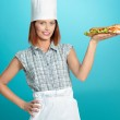 Chef holding a big sadwich in hand — Stock Photo