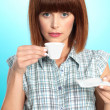Attractive young woman drinking an espresso coffee — Stock Photo #10114328