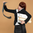 Busy, young businesswoman holding laptop, papers, telephone — Stock Photo