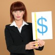 Attractive, young businesswoman measuring dollar sign — Stock Photo