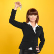 Attractive, young businesswoman holding house keys — Stock Photo