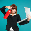 Attractive businesswoman, using fire extinguisher on laptop — Stock Photo