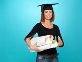 Pretty young woman in graduation outfit — Stock Photo
