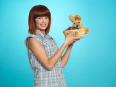 Attractive young woman giving easter eggs basket — Stock Photo