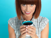 Attractive young woman drinking her morning coffee — Stock Photo