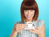 Attractive young woman drinking an espresso coffee — Stock Photo