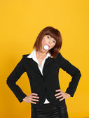 Attractive, young businesswoman with egg in mouth — Stock Photo