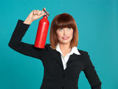 Attractive businesswoman, using fire extinguisher on head — Stock Photo