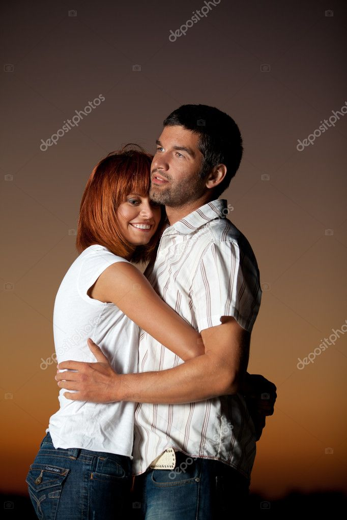 Sexy, young couple playing holding each other on the beach, after sunset, smilling — Stock Photo #10111246