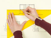Woman's hand drawing architectural sketch of house — Stok fotoğraf