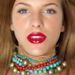 Closeup beauty portrait woman with colorful jewels — Stock Photo