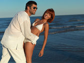 Happy, young couple by the sea shore — Stock Photo