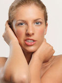 Closeup beauty portrait young woman crooked expression — Stock Photo