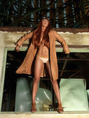 Fashion portrait woman aviator outfit window frame — Stock Photo