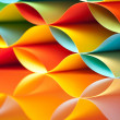 Stock Photo: Curved, colorful sheets paper with mirror reflexions