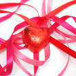 Royalty-Free Stock Photo: Candy in red foil and red satin ribbon
