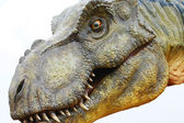 Dinosaur Tyrannosaurus rex on white — Stock Photo