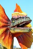 Dilophosaurus dinosaur with orange collar — Stock Photo