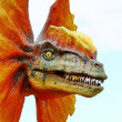 Stock Photo: Dilophosaurus dinosaur with orange collar