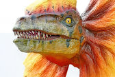 Dilophosaurus dinosaur with orange collar — Stock Photo