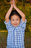 Happy Asian Boy Playing With Autumn Leaves — Stock Photo