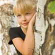 Stock Photo: Portrait of girl near birch