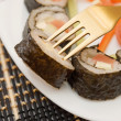 Sushi on a fork — Stock Photo