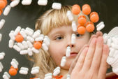 Child playing with drugs — Stock Photo